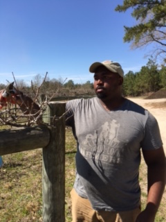 Fussy Gourmet farm manager, Davon Goodwin, hand prunes acres and acres of grapes. Photo by Lari Powell Hatley