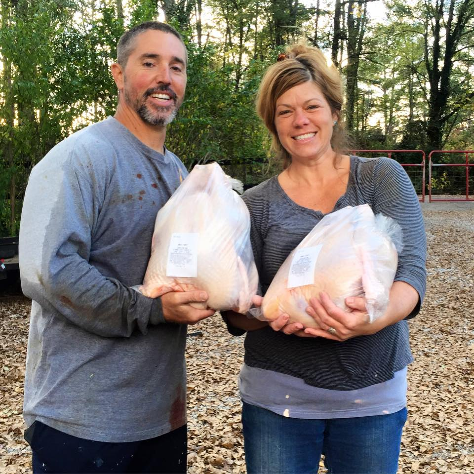 Chris and Jason with their turkeys ready for sale. Every aspect of production happens on the farm.