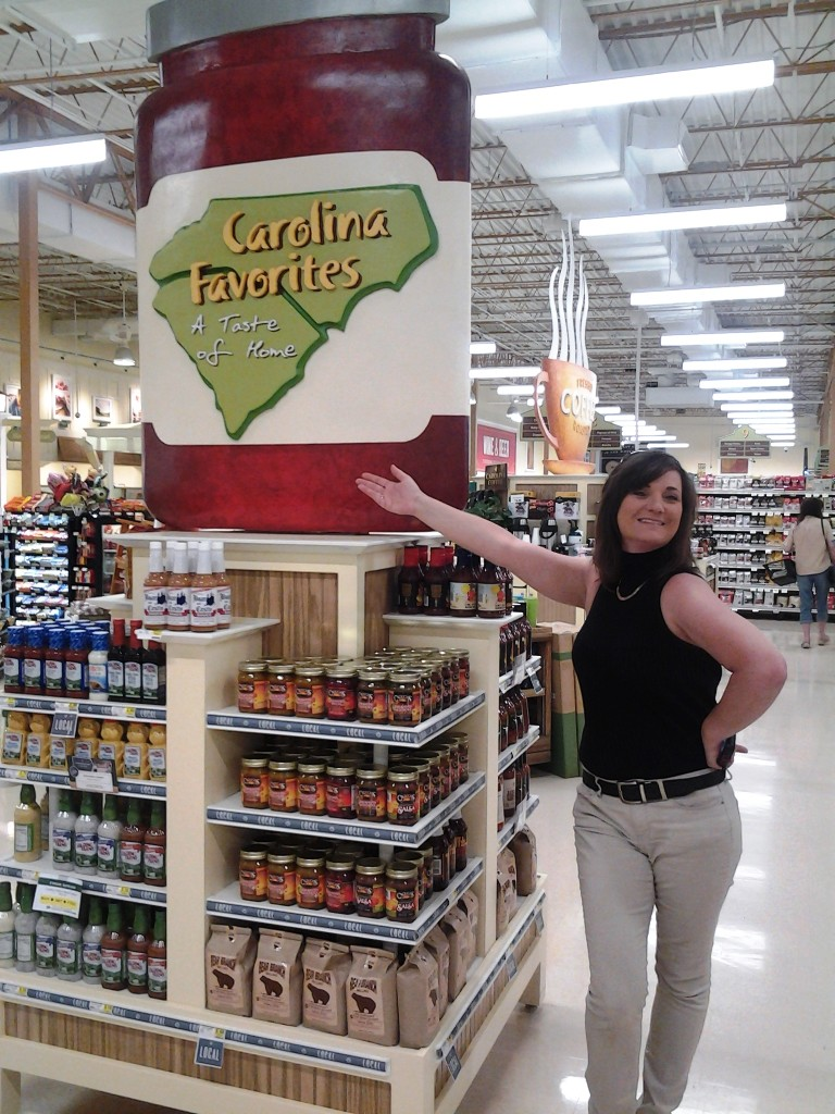 Angie proudly shows off their display at Lowes Foods Photo submitted by Angie Olear
